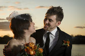 Portrait of newlyweds looking at eachother — Stock Photo