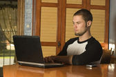Puzzled young male surfing the web — Stock Photo