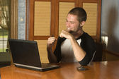 Successful young man on laptop — Stock Photo