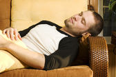 Young man taking a nap on couch — Stock Photo