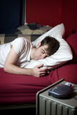 Young man sleeping in bed — Stock Photo