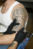 Arm of man getting tattooed — Stock Photo