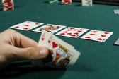 Watching poker game with winning hand — Stock Photo