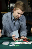 Young poker player going all in — Stockfoto
