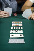 Line up of cards on poker table — Stock Photo