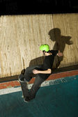 Skateboarder going up ramp to do a trick — Stock Photo