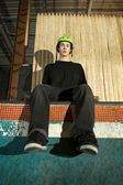 Skateboarder without his board on ramp — Stock Photo