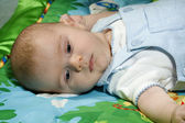 Baby boy on colorful blanket — Stock Photo