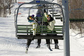 Two sisters on chair lift — Stock Photo
