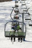 Chairlift full of — Stock Photo