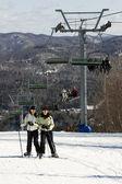 Two girls skiing on slopes — Stock Photo