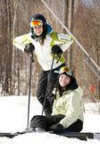 Two girls on ski slopes — Stock Photo