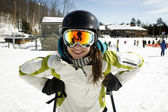 Portrait of young girl with ski poles — Stock Photo
