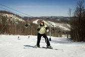 Beautiful girl skier on mountain slope — Stock Photo