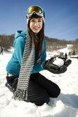 Young girl playing in snow at ski resort — ストック写真