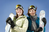 Portrait of two girls holding there skis — Stock Photo