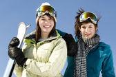 Portrait of two girls in ski gear — Stock Photo