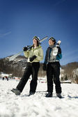 Two girl skiers hanging out — Stock Photo