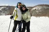 Two sisters happy to be on ski slopes — Stock Photo