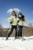 Two beautiful girls skiing — Stock Photo