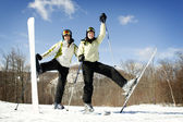 Two Girls on mountain top ready for skiing — Stock Photo