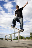 Skateboarder doing a crooked grind — Stock Photo