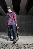 Skateboarder standing on path underground — Stock Photo