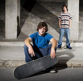 Two skateboarders posing for camera — Stock Photo