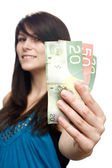 Young woman holding currency — Stock Photo