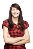 Jeune fille avec bras croisés souriant — Photo