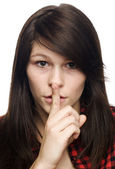 Young woman making sign to keep quiet — Stock Photo