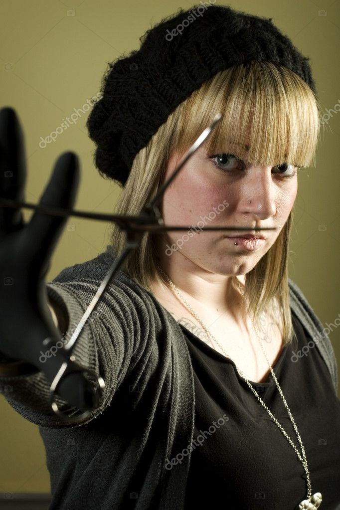 Portrait of woman holding forceps in front of her face — Stock Photo #5852450