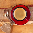 Espresso coffee, red enamel mug, two old silver spoons, two wood — Stock Photo #5611645