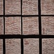 Old historic beamed house brick wall in spain — Stock Photo #5611788