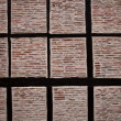 Old historic beamed house brick wall in spain — Stock Photo