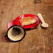 Overturned espresso coffee in red enamel mug with saucer, woode — Stock Photo