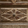 Old ornamental design in wood, wooden carved door detail - Stock Photo