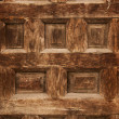 Old ornamental design in wood, wooden carved door detail — Stock Photo #5611943