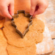 Little girl with  cutter make a christmas tree cookie — Foto Stock
