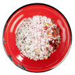 Постер, плакат: Seasoned sea salt in enamel red plate isolated
