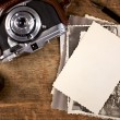 Stock Photo: Vintage ink and pen, old photos and camera on old wooden table
