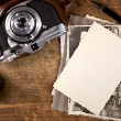Vintage ink and pen, old photos and camera on old wooden table — Stock Photo #5612686