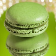 Macaron Matcha Green  with its own reflection mirror backdrop - Stock Photo