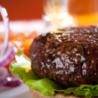 Beef burger with onion and beer on background — Stock Photo #5612951