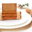 Aromatic christmas place setting place with card, holly twig in — Stock Photo #5613177