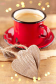Espresso coffee, red enamel mug, two wooden hearts and festive — Stok fotoğraf