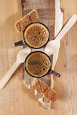 Espresso for two with spoons and Cantuccini Biscotti on wood — Stock Photo
