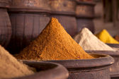 Spices pile (Curry Powder) in the Marrakesh street shop — Stock Photo