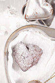 Chocolat muffin dusted sugar, heart shape trays — Stock Photo