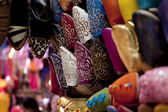 Ornamented traditional moroccan shoes in medina street souk — Stock Photo